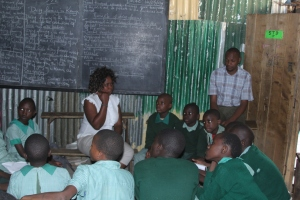 Children and teachers as Furaha Community Center discuss their nighbourhood