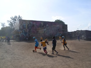 Children playing in Austin's playground. Austin, a Mathare footballer, organized the kids to clean up a dumping ground to make a place to play.
